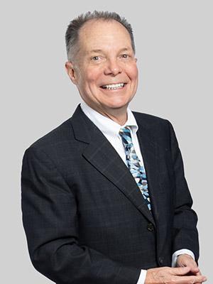 John D. Dadakis